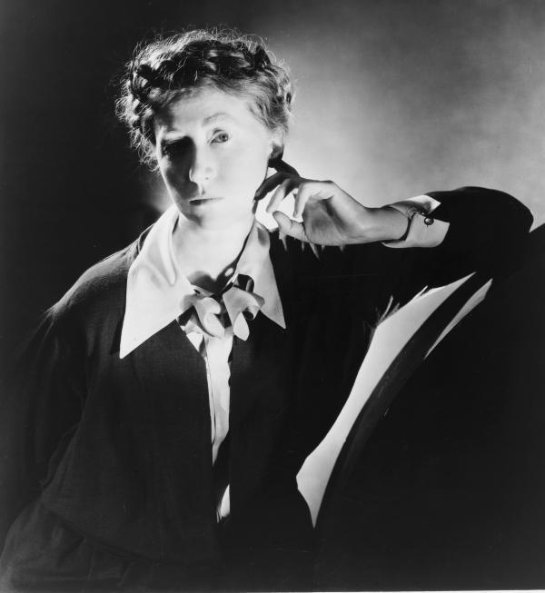 Marianne Moore, half-length portrait, facing left