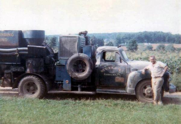 "Parke Myer with his truck mounted ""hammer mill,"" West Pikeland, PA, August 1965."