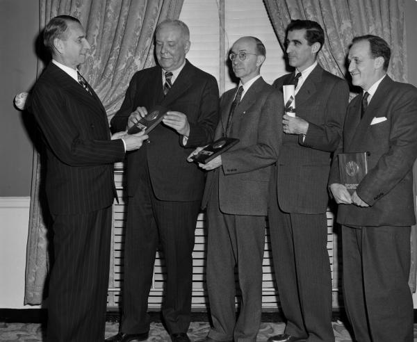 """The second annual National Book Awards, for outstanding works by American authors, were made at the Hotel Commodore. Left to right are: Edward A. Weeks, editor of the Atlantic Monthly, who presented the awards; Wallace Stevens, the poetry award, for """"The Auroras of Autumn;"""" Newton Arvin, who won a special citation for his first novel, """"The Trouble of One House;"""" and Saxe Commins, Random House editor, who accepted the plaque for Nobel-Award Winner William Faulkner, for """"The Collected Stories of William Faulkner."""""""