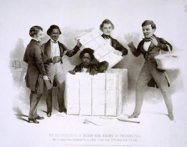 In the office of the Pennsylvania Anti-Slavery Society, the young Brown emerges from a crate as several figures, including Frederick Douglass (holding a claw hammer at left) look on.
