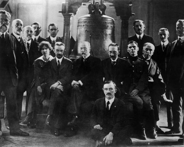 Representatives of participating nations gather at Independence Hall in Philadelphia on October 26, 1918 to sign the Declaration of Common Aims of the Independent Mid-European Nations. Seated at the center, directly under the crack of the Liberty Bell, is Dr. Thomas G. Masaryk.