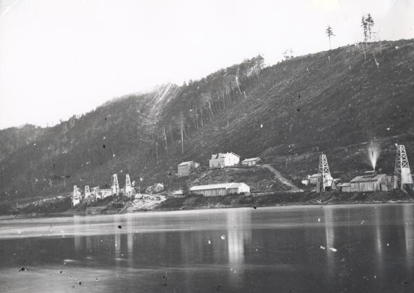 Black and white exterior of buildings along the water