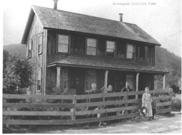 Exterior and fence, with family members and a dog