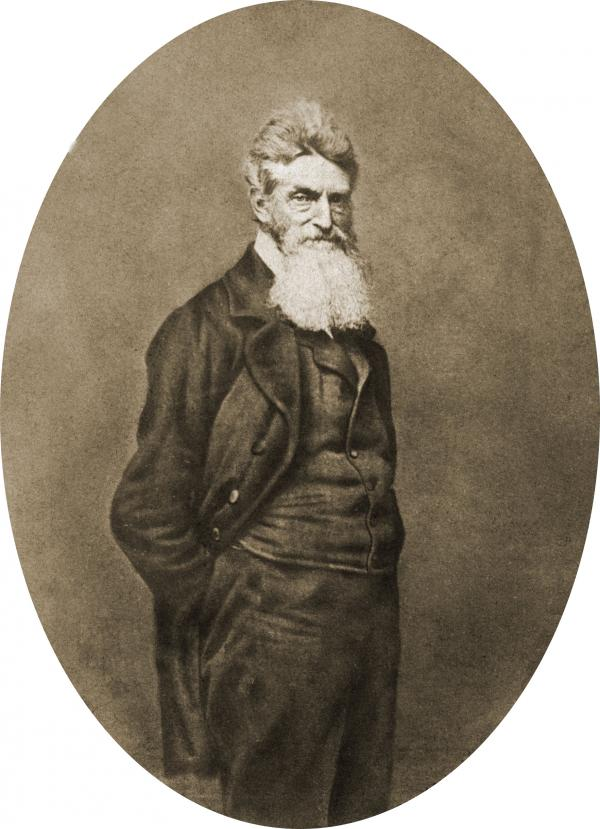 Photograph showing three-quarter length portrait of John Brown, with beard, facing slightly right.