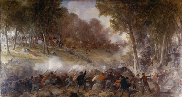 Oil on canvas painting of a battle scene. In the foreground are soldiers with their backs to the viewer and smoke from their gun fire is thick in front of them. In the far background, a fallen soldier lies on the ground while others are being wounded as they charge forward. A black dog leaps out ahead of the charging soldiers.