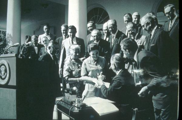Signing of the wilderness act, 9/3/1964; Johnson giving pen to Alice Zahniser (Mardy Murie looking on)
