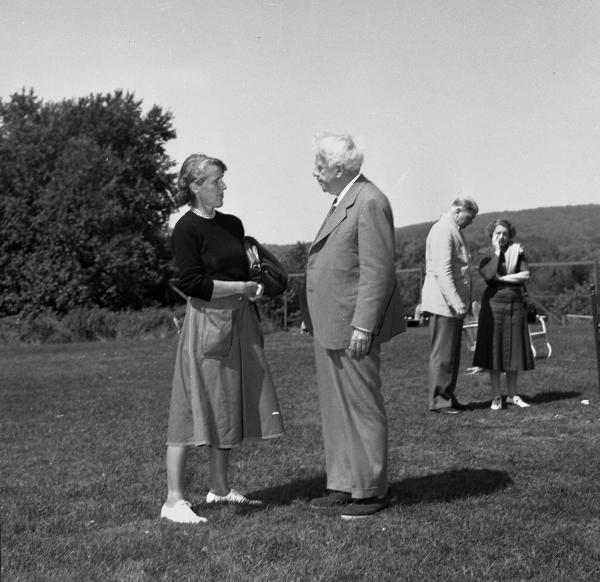 Catherine Drinker Bowen and Robert Frost. Bread Loaf campus, Ripton, Vt.; August 1950. Writers' Conference faculty member Catherine Drinker Bowen with Robert Frost. Kay Morrison and Richard Brown are in the background.