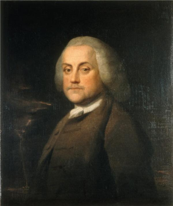Color portrait of Benjamin Franklin wearing a brown suit with a white dress shirt showing at the collar area.