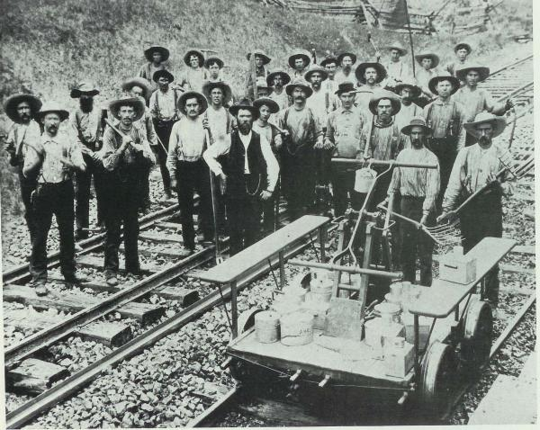 Track workers with tools, hand car in lower right Section gang Oakdale