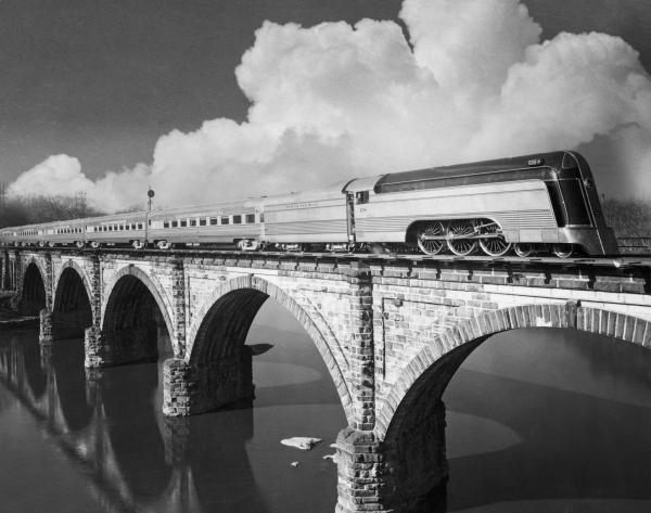 The streamline Crusader crossing a Railway Bridge