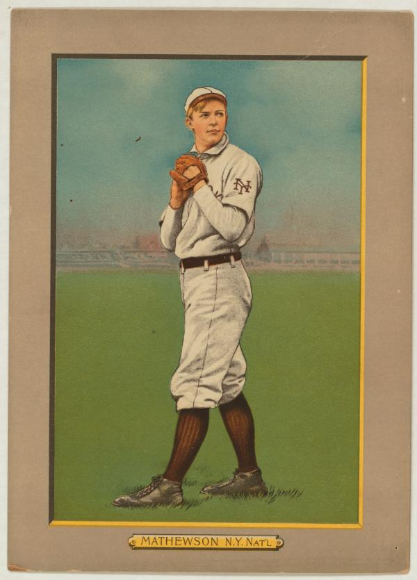 Baseball card, full length, in wind-up.