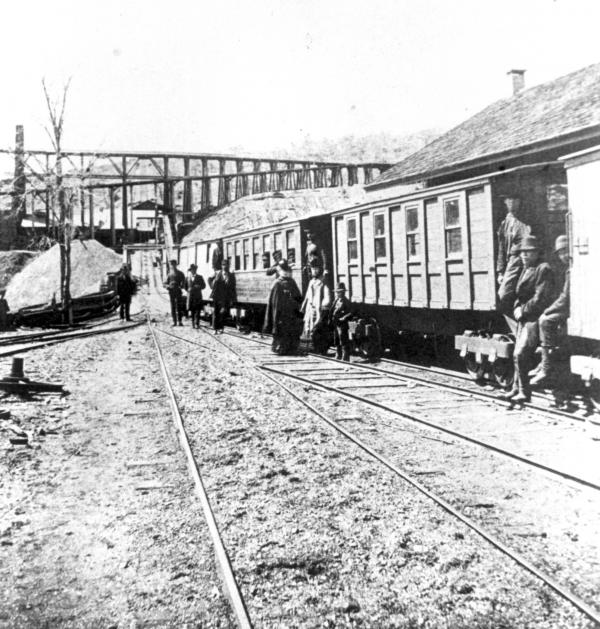 """This train began its journey ascending Plane 13, which appears in the distance and passed under the Company's """"high works"""" or trestles."""