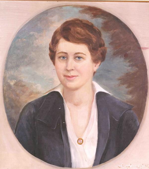 Oval shaped image set inside pink corners.  Painted from a portrait of Flora at about the time she started the Farm Women's Society in 1914. She is wearing a dark suit and pink blouse.