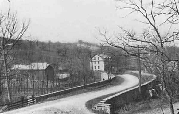 "The ""S"" Bridge, shown here in an 1894 photograph, was completed in 1818. This and other early bridges facilitated travel on the National Road."