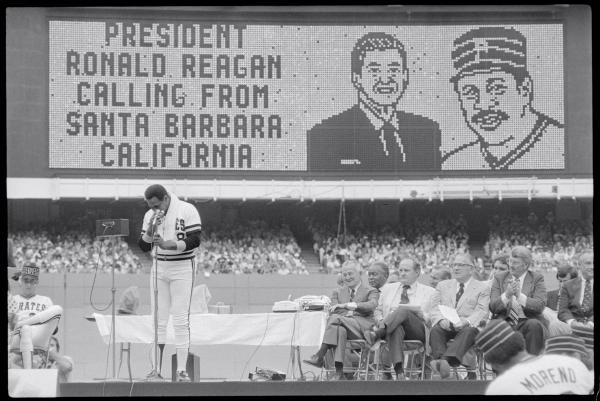 Willie Stargell bows his head and wipes his tears, as he receives a congratulatory message from the President of the United States, Ronald Reagan.