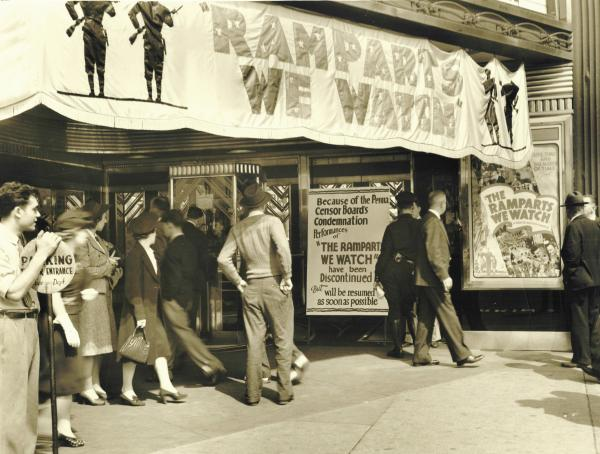 "Exterior of theater with sign that has stopped screening ""The Ramparts We Watch."""