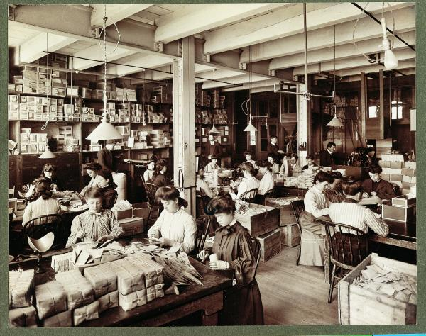 Image of Burpee female employees working in the seed packing plant.