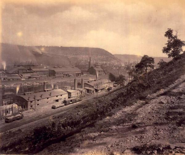 William Rau photograph of the Cambria Iron Works and Johnstown, 1891. Smoke rises from the stacks of the enormous iron works.