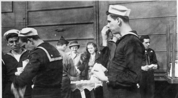 Sailors stand outside of the Connelsville Canteen.