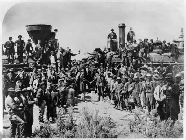 Completion of the First Transcontinental Railroad. Railroad workers celebrate at the driving of the Golden Spike Ceremony in Utah on May 10, 1869.