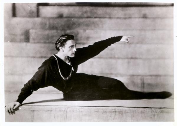 John Barrymore, as Hamlet, reclining on steps.