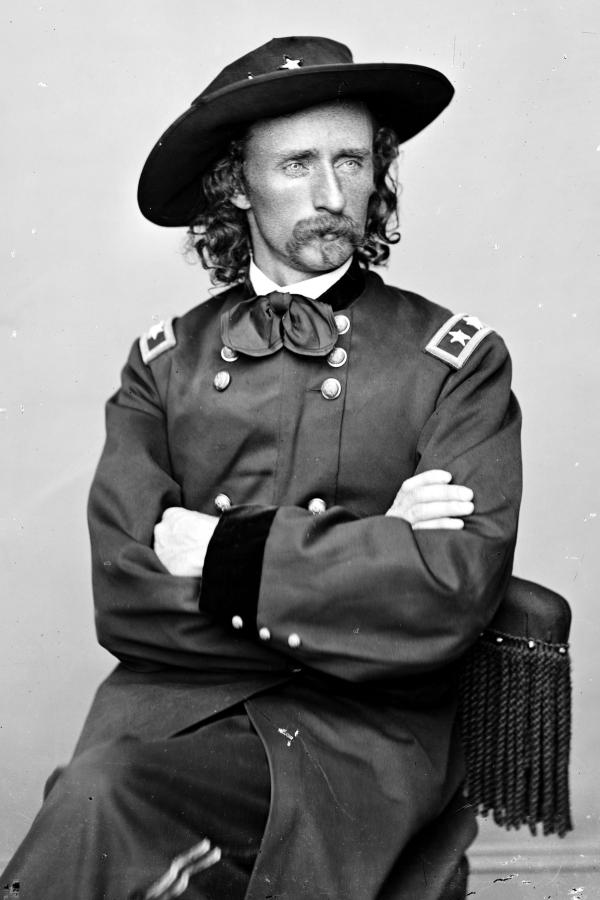 Classic photograph of George Armstrong Custer in slouch hat.