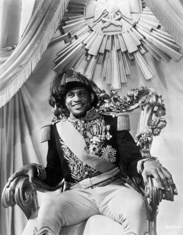 Robeson dressed as an emperor, sitting on a throne.