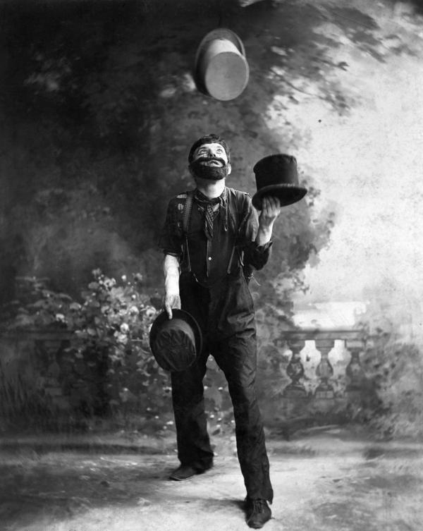 W.C. Fields Juggling Top Hats.