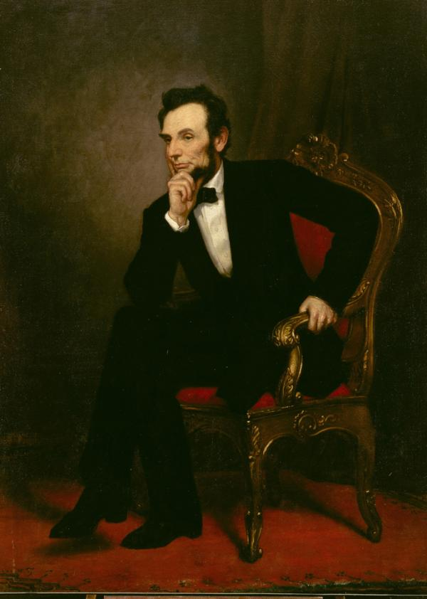 Oil on canvas of Abraham Lincoln sitting in an oak chair with red velvet back and seat. His arm bends at the elbow and rests on his knee, while his chin rest in his hand, as he seems to attend to other voices.