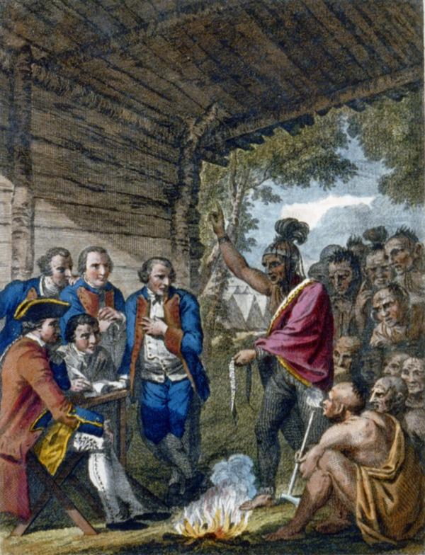 This image depicts a treaty council between Indians and Europeans on the Pennsylvania frontier.  An Indian orator speaks over the council fire while using a wampum belt to make his point.  One of his compatriots smokes from a pipe tomahawk.  British officers listen with rapt attention (one places his hand over his heart), while a secretary records the proceedings.