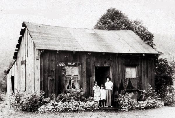 In this photograph, an Indian family poses outside a typical home on the Cornplanter Tract in the mid 1900s.