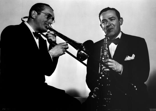 Tommy Dorsey playing the trombone and Jimmy Dorsey playing the saxophone