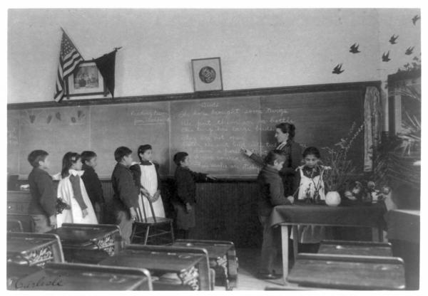 Indian Boys and Girls in a Carlisle School Classroom.