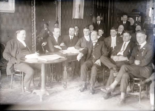 A conference of leaders of the steel strike at the Pittsburgh headquarters. Seated at the table at left are John Fitzpatrick, organizer of the steel workers, and William Z. Foster, director of the strike.