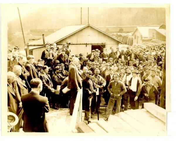 Image of Pat Fagan standing on a platform addressing a crowd of miners.