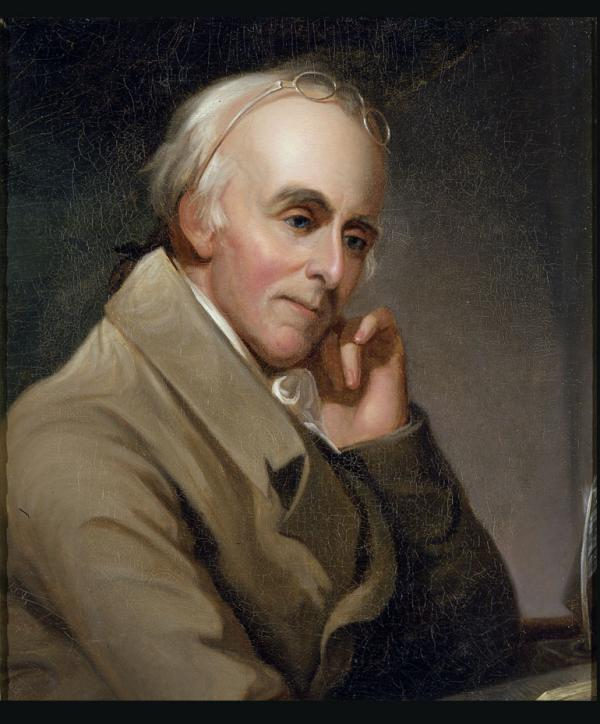 Oil on canvas of Benjamin Rush as he sits at his desk, elbow resting on the desk and his head rests against his hand. His glasses are propped on the top of his balding head.