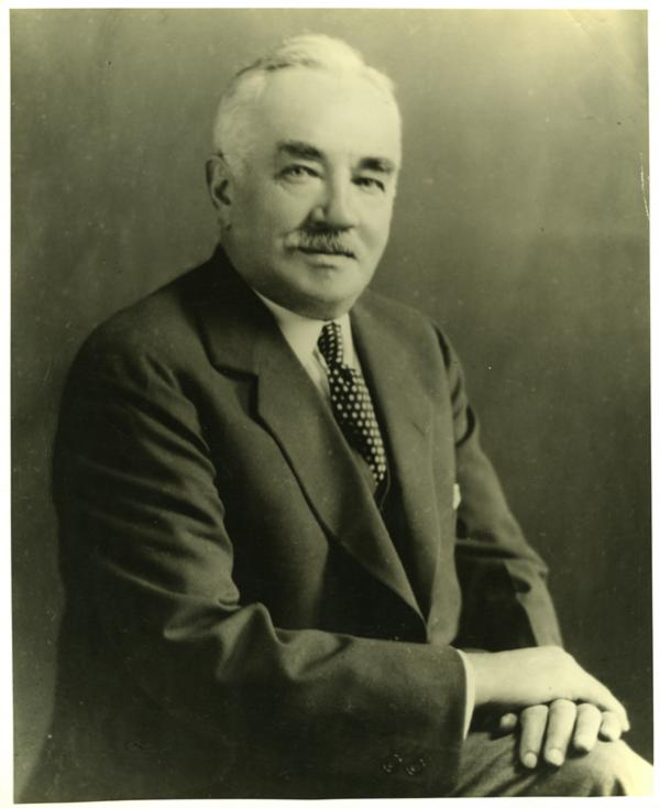 Milton S. Hershey, 3/4 length portrait; seated with legs crossed and hands on knees.
