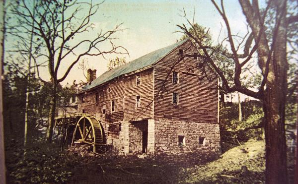 Early-20th-century hand-colored photo of the Grist Mill