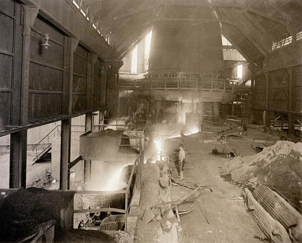 A dynamic image of the inside of Duquesne Steel and a worker tapping iron from a blast furnace.