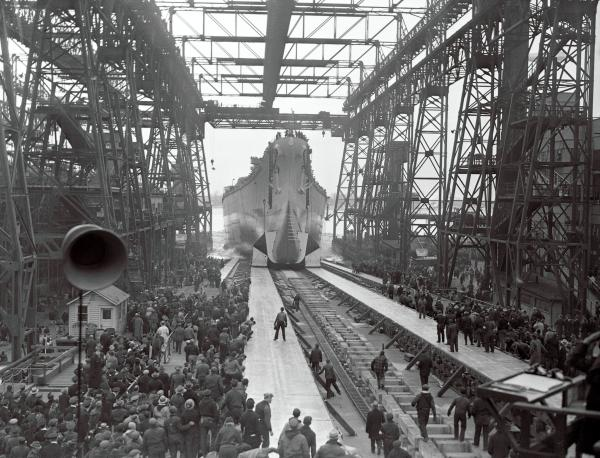 """The new super warship U. S. S. New Jersey is a sister ship of the Iowa launched at Brooklyn. She is shown as she left her ways at the Philadelphia Navy Yard."""