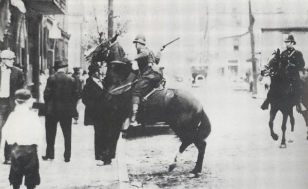 State Trooper assaulting bystander in Homestead, 1919.