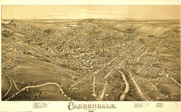 Birds eye view of the town of Carbondale, with numbered identification legend which includes the following: 7. Hendricks MFG Co. 9. Grist Mill Brownson and Fowler 10. Planing Mills 11. Breaker, Rease and Mosier 12. Colebrook Breaker Visible in the upper left corner of the image are two coal breakers