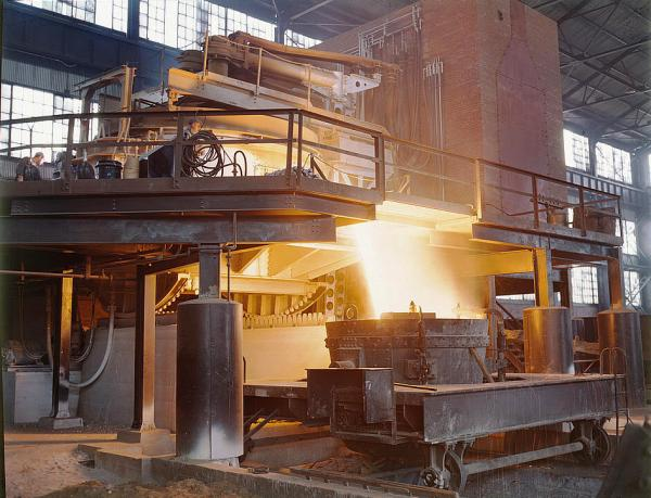White-hot steel pours like water from a 35-ton electric furnace.