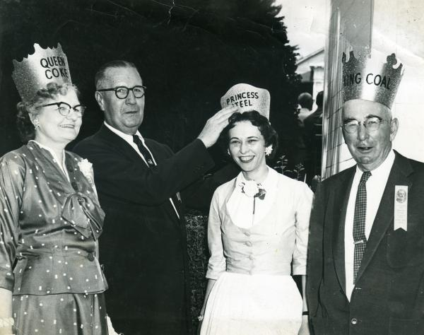 Image of the crowning of Princess Steel, while an already crown King Coal and Queen Coke look on.