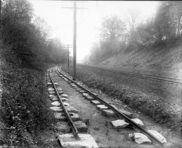"""Early iron T-rail track laid on stone """"sleepers"""" from the Camden Amboy railroad in New Jersey."""