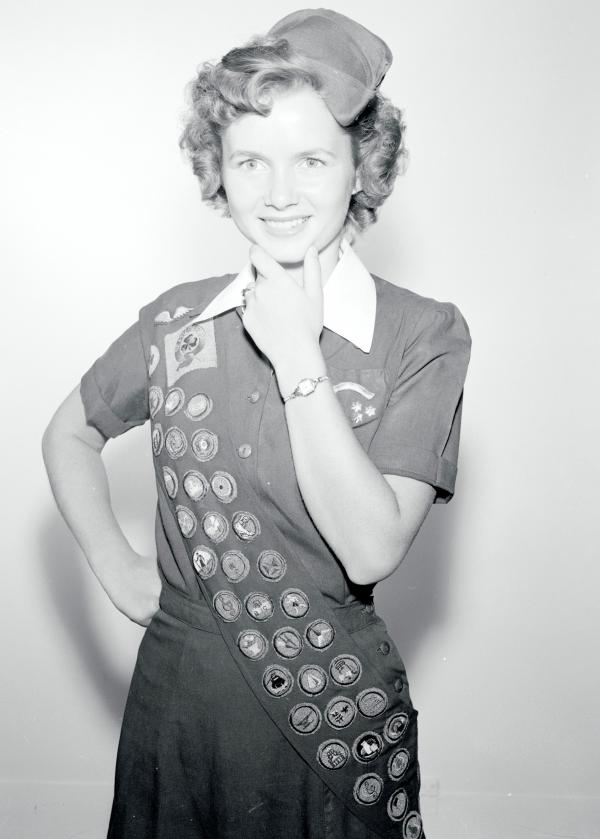 Debbie Reynolds poses in her Girl Scout uniform.