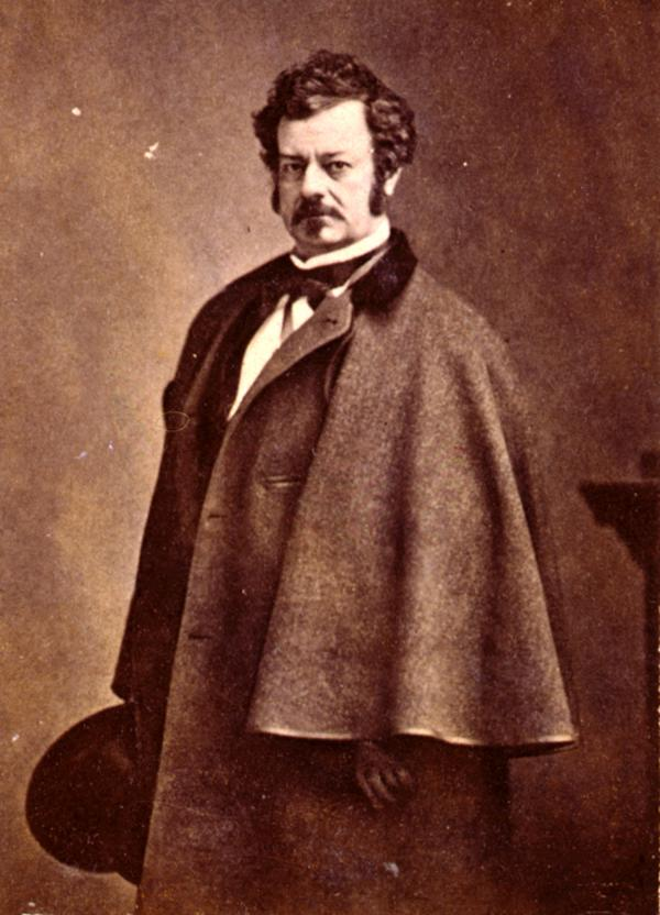 Edwin Forrest, half-length portrait, standing, facing left, wearing caped overcoat.