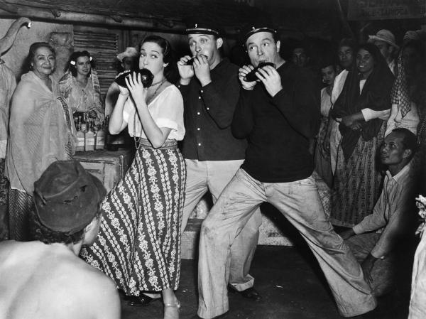 Dorothy Lamour, Bing Crosby, and Bob Hope playing ocarinas in a publicity still.