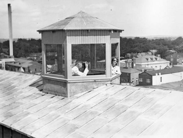 Civil Defense Air Raid wardens, Mr. Woodward and Miss Miles atop Farmers and Mechanics Building at High and Market Street.