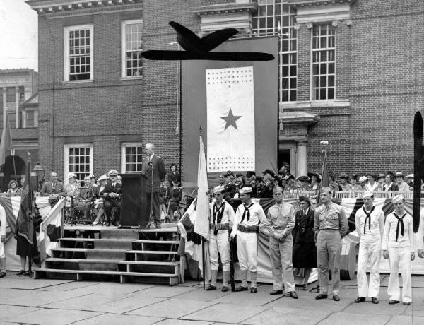 Gov. Edward Martin speaking at ceremony outside Independence Hall, where he was receiving the first Service Flag from Emergency Aid of Pennsylvania on June 3, 1943.